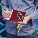 man holding a notebook